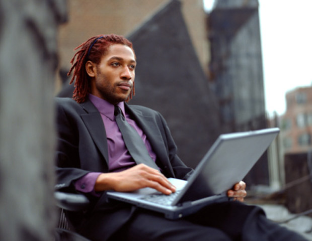 Man with Dreadlocks in a Business Suit