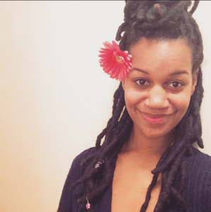 Thick Locs with Flower Accessory