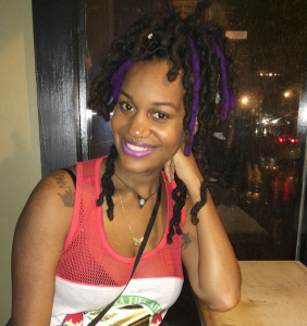 Thick Locs with Purple Highlights