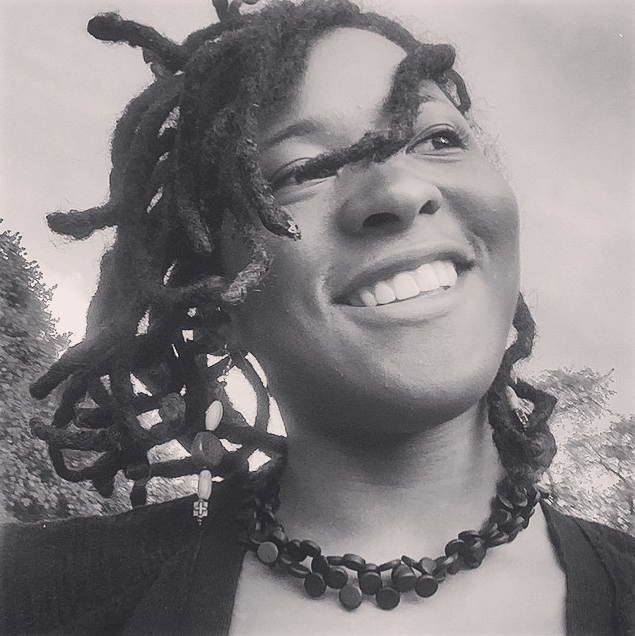 CurlyNuGrowth Smiling in Selfie of Thick Locs at 2.5 years