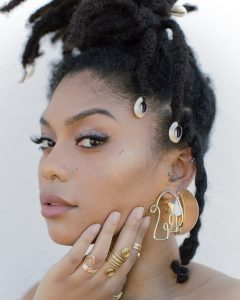 black women with loc jewelry