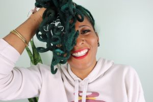 black woman with green locs