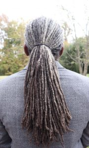 black man with grey locs