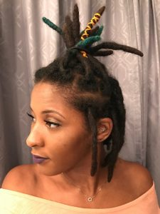 black woman with a ponytail and locs
