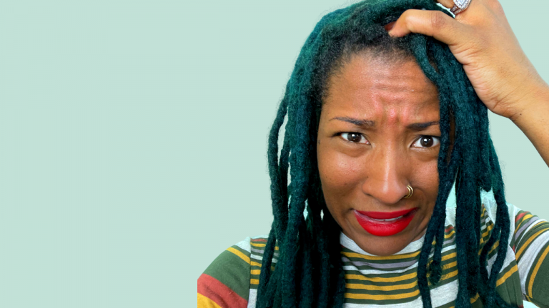 black woman with locs itching scalp
